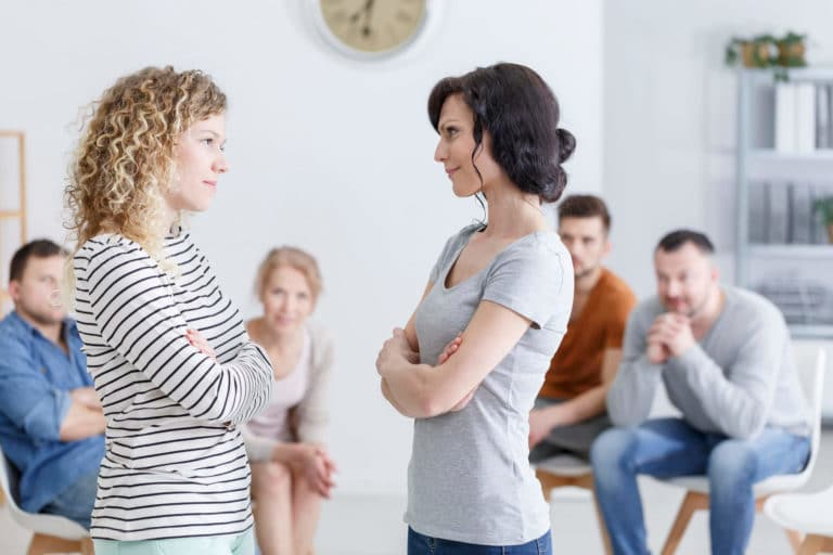 two-women-during-group-psychotherapy-P2MK4BU-scaled.jpg